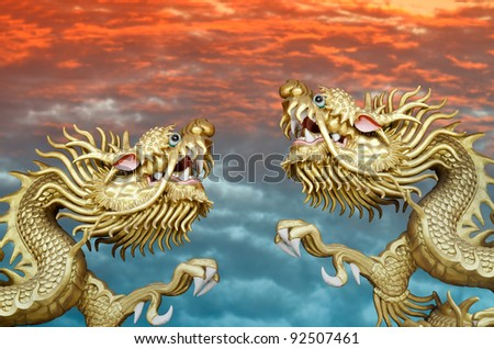 flying twin golden dragons on two tone skies