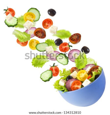 Flying vegetables for Greek salad Healthy food