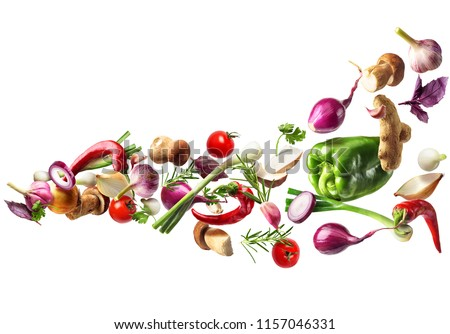 Flying vegetables isolated on white background.Healthy nutrition