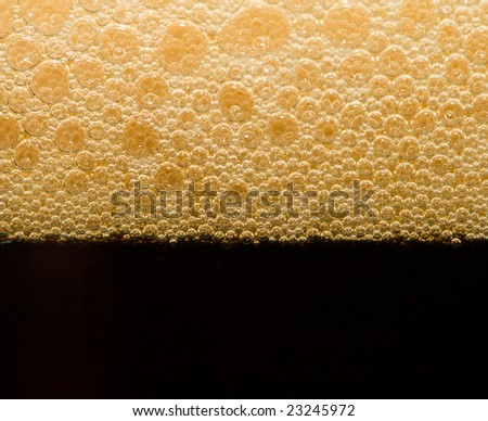 foam from dark beer with bubbles
