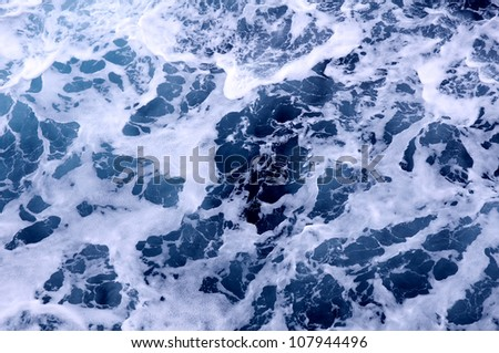 foam on the blue sea