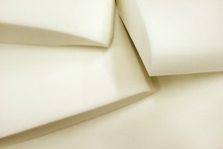 Foam rubber.Molded pieces of foam. Production of upholstered furniture, details. Close-up photos, selective focus.