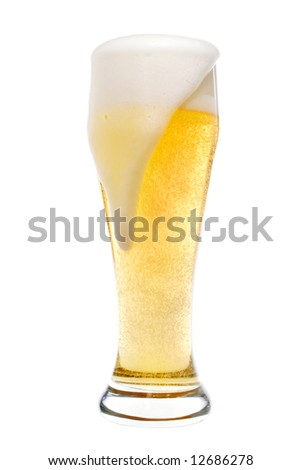 Foaming beer in a pilsner glass