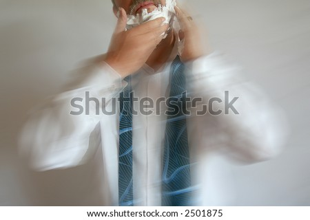 Foaming Businessman running late for work with Motion Blur