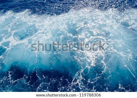 Foamy surface of sea water, shot in the open sea directly from above