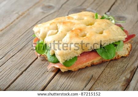 focaccia with ham and salad