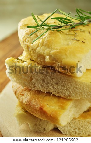 Focaccia with rosemary, olive oil and coarse salt, selective focus