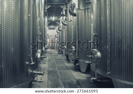 Focsani, Romania - October 16: Stainless steel fermenters used to make wine inside winery Garboiu, on 16 October, 2014, Focsani, Romania