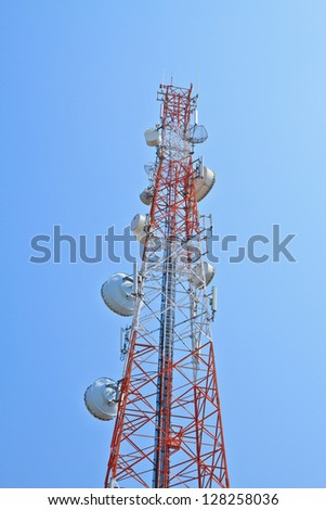 Focus at telecommunication tower, Blue sky background. Used to transmit television signals.