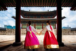 Focus at the old building, Korean lady in Hanbok or Korea gress and walk in an ancient town and Gyeongbokgung Palace in seoul, Seoul city, South Korea.