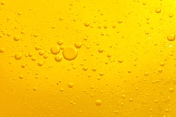 Focus boiling yellow oil spread widely bubble texture full frame and macro many various droplets