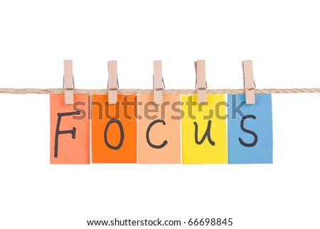 Focus, Colorful words hang on rope by wooden peg