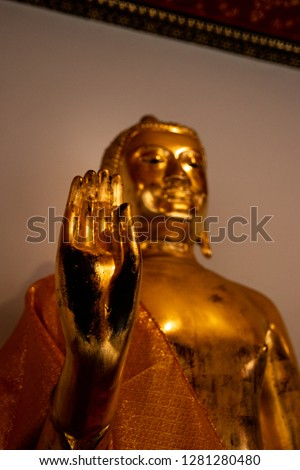 Focus Hand Gold Buddha this action mean Sometimes imperfection made perfection .This pic focus hand