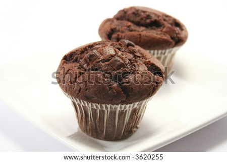 focus is on front muffin - double choc chip