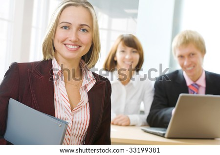 Focus is on the businesswoman in front