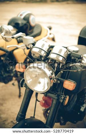 focus on a headlamp. Retro motorcycle with headlight #528770419