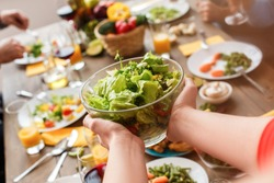 Focus on a useful salad in the hands of the woman