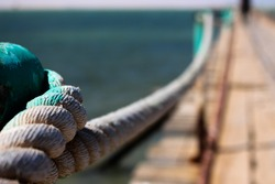 Focus On Dock, Rope and Blurry Sea