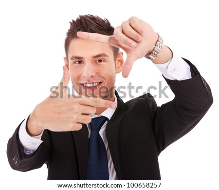 Focus on executive making frame with his hands on white background - stock photo
