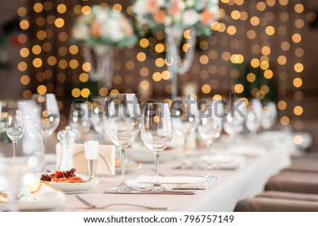 focus on glasses. Banquet table in the restaurant, the preparation before the banquet. the work of professional florists. - Shutterstock ID 796757149
