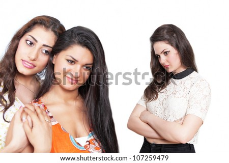 Focus on lonely girl with two happy women in foreground