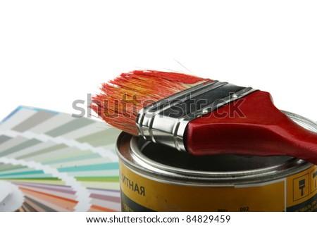 Focus on paintbrush and brush on white background