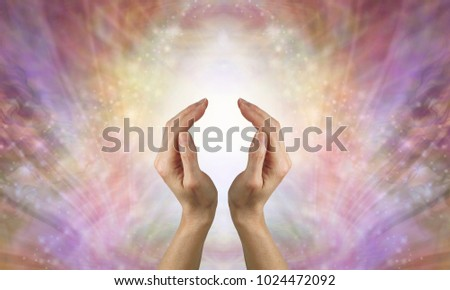 Focus on sending pure unconditional love healing energy- female hands in cupped position against a beautiful feminine gold shimmering sparkle background depicting unconditional love