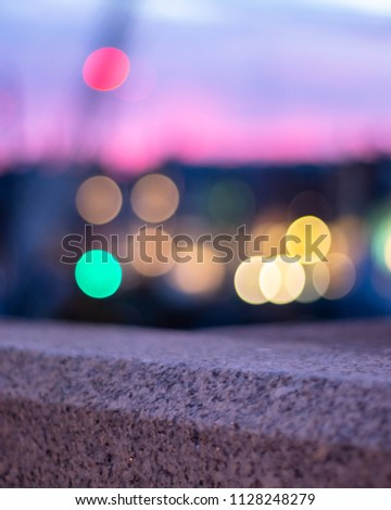 Stock Photo Focus on stone railing with bokeh in background