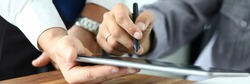 Focus on workers hands holding tablet. Manager giving for signature e-documents. Director signing important contract. Business concept. Blurred background