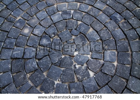 focus stones on a sidewalk, arranged in a circular pattern