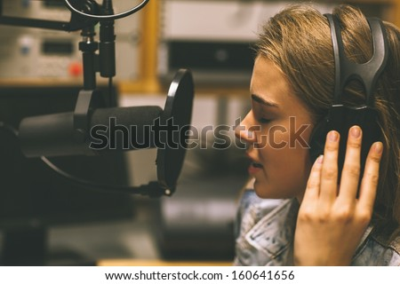 Focused Pretty Singer Recording A Song In Studio At College