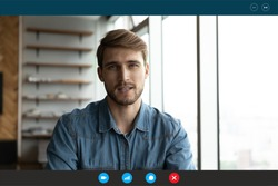 Focused young european appearance man passing online job interview, sharing working experience with hr manager or employee communicating with clients, computer video call application screen view.