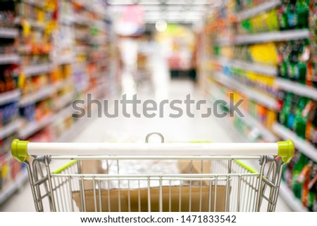 Focusing trolley in supermarket and blur product
