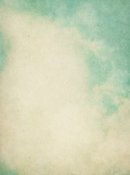 Fog and clouds on a textured vintage background with grunge stains.  Image has a pleasing paper grain visible at 100%.