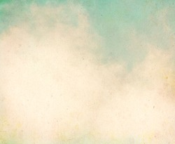 Fog and clouds on a textured, vintage paper background with grunge stains.  Image displays a pleasing grain texture at 100%.