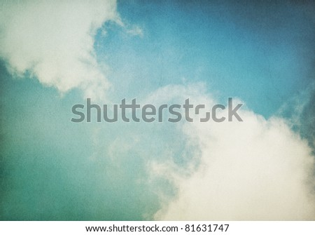 Fog and clouds on a vintage, textured paper background with a color gradient.  Image has a distinct and pleasing paper grain at 100%.