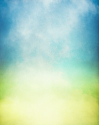 Fog and mist rising from a glowing pool of yellow and green light.  Image has a textured paper overlay and grain pattern visible at 100%.