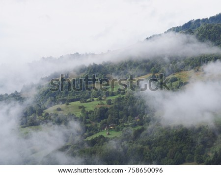 Fog at the village in the carpatian mountains  #758650096
