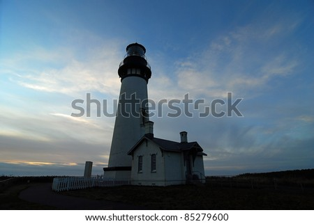 Fog Bank rolling in as sun set on Yaquina Head Lighthouse on Pacific Coast of Oregon near Newport Beach.