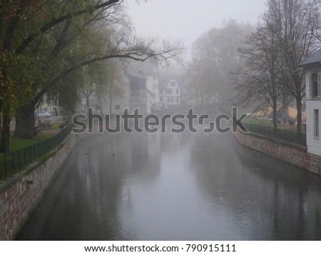 fog, city in fog, houses in fog Strasbourg #790915111
