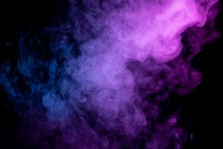 Fog colored with bright pink and blue smoke gel on dark background