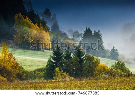 Fog early morning in the mountains at autumn - Shutterstock ID 746877385