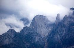 FOG ENVELOPES THE GRANITE ROCK FACE OF CASTLE ROCKS IN SEQUOIA NATIONAL PARK,CALIFORNIA