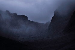 Fog in rocky mountain valley.Dark and dramatic landscape scene with atmospheric mood in English Lake District.
