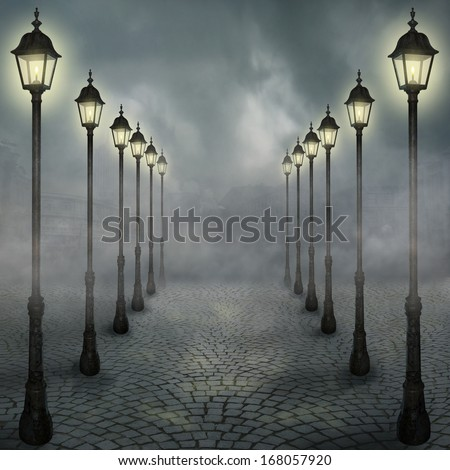 Fog in the park with street lamps