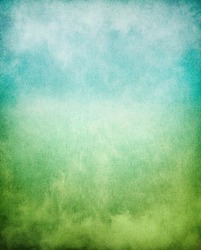 Fog, mist, and clouds with a green to blue gradient.  Image has a pleasing paper texture and grain pattern visible at 100%.