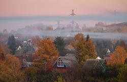 Fog over the autumn village in Russia