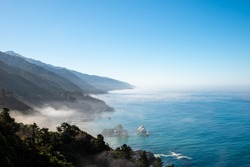 Fog over the ocean. View of the Pacific Coast in California, USA