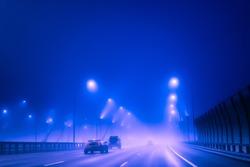 fog. Road and a car in fog