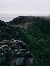 Fog rolls in while we are Hiking the East Coast Trail by Signal Hill in St. John's Newfoundland at sunset. Beautiful rugged scenery.